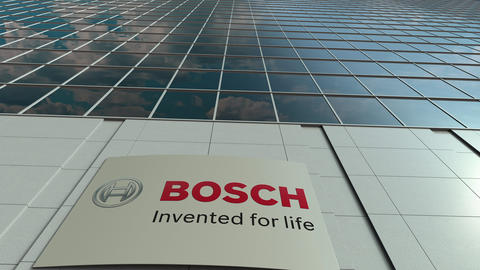Signage board with Robert Bosch GmbH logo. Modern office building facade time Live Action