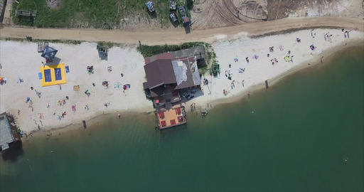 Aerial view of people on a sandy beach at Lake Footage