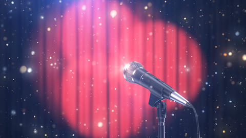 Microphone with Magic Particles against Blurred Red Curtains with Rotating Spotlights Animation
