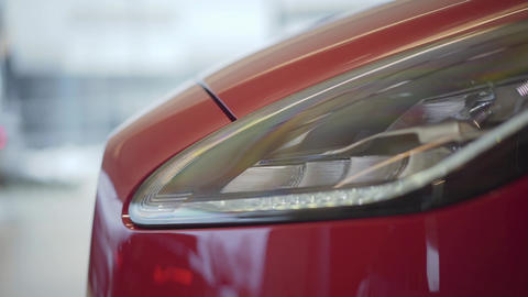Car headlight. Automobile standing in car showroom Live Action
