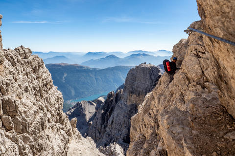 Male mountain climber on a Via Ferrata in breathtaking landscape Photo