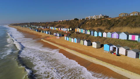 The colorful huts at the English South coast from above Live Action