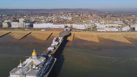 Flight over Eastbourne pier at the south coast of England Live Action