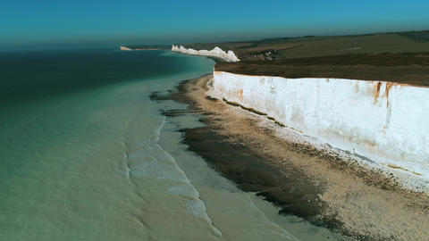 Flight over the white cliffs of Beachy Head and Seven Sisters in England Live Action