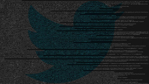 Twitter logo made of source code on computer screen. Editorial loopable Live Action