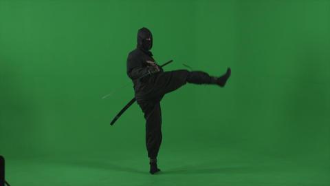 Ninja does quick sword and kick movements Footage