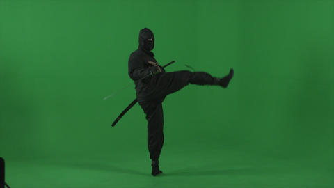 Ninja flourishes his sword, performs kicks and flips expertly in studio Footage