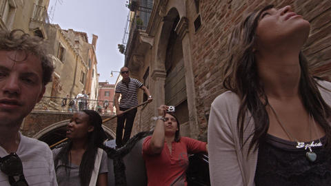 Rear-facing view in gondola facing toward people and gondolier Footage