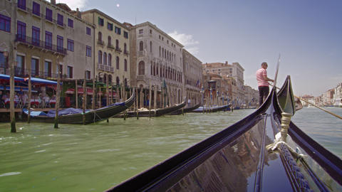 Gondola follows other gondola down the Grand Canal Footage