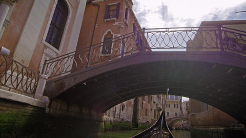 Slow motion shot of gondola under bridge Footage
