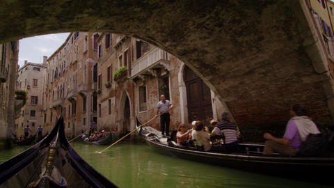 Gondolas pass under a bridge in slow motion Footage