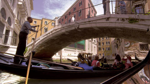 Gondola passes beneath pedestrian bridge Footage