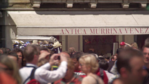 Slow motion shot of crowded street below awning Footage