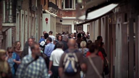 Slow motion shot as people stroll down a Venetian lane Footage