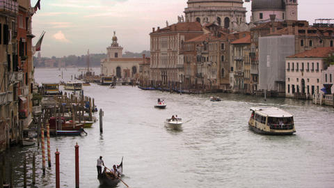 Boats and gondolas on a canal near Santa Maria della Salute Footage