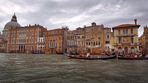 Gondolas and waterfront buildings of Venice Footage