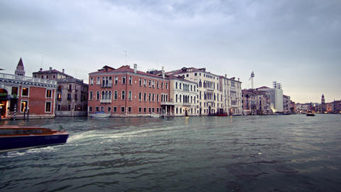 Tracking footage of buildings on the waterline of the Grand Canal Footage