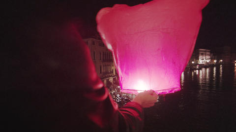 Paper lantern being set off from Rialto Bridge Footage