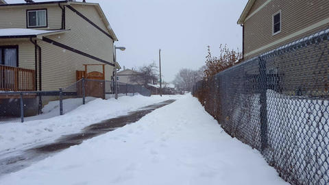 Residential Walkway Between Houses While Snowing in... Stock Video Footage