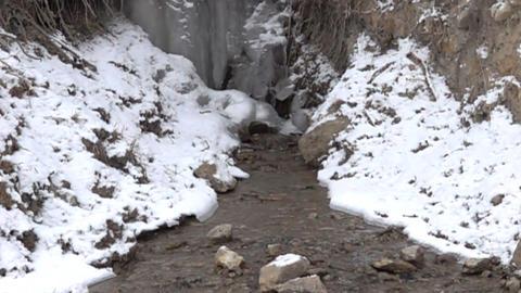 Mountain creek. Frozen waterfall Footage