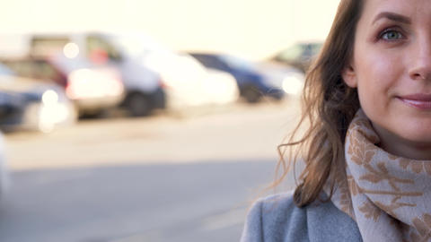 Portrait of a woman with a hairstyle and neutral makeup on a city background Footage