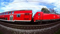 Red regional train passing by ビデオ
