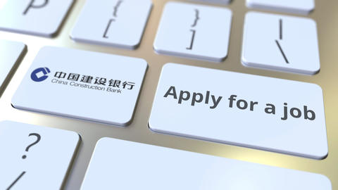 Computer keyboard with CHINA CONSTRUCTION BANK logo and Apply for a job text on Footage