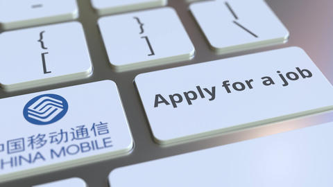 Keyboard with CHINA MOBILE company logo and Apply for a job text on the keys Footage
