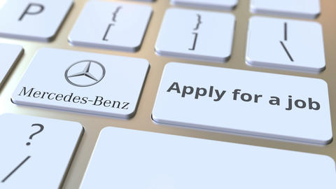 MERCEDES-BENZ company logo and Apply for a job text on the keys of the computer Footage