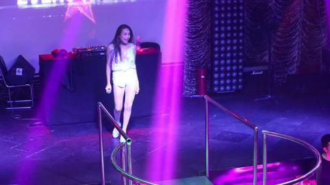 pretty girl pop star sings song on nightclub stage Footage