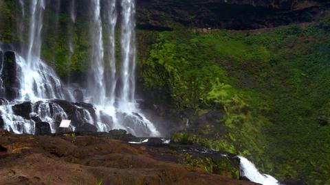 sun rays light powerful foamy waterfall jets in park Footage