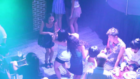 upper view youth dance in neon lights on nightclub floor Live Action