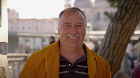 Portrait shot of an artist smiling for the camera in Venice Live Action