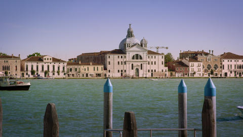 Panning shot of Giudecca across the canal from a marina Footage