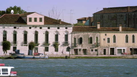 Tight panning shot of the Giudecca from across the canal at a marina Footage
