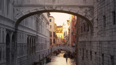 Tilt shot of the Bridge of Sighs and the canal beneath it Footage
