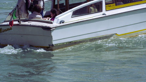 Slow motion shot of a motor boat focusing on the turbulent water created by the  Footage