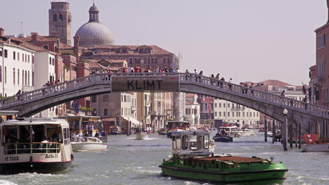 Slow motion shot of the packed Grand Canal with tourists crossing the Ponte Scal Footage