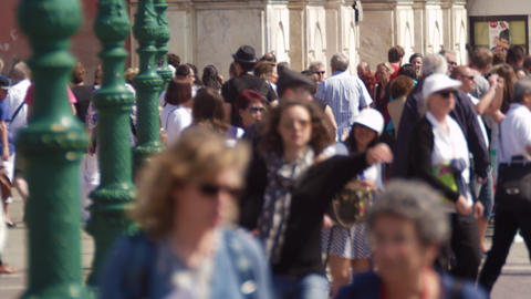 Slow motion shot of crowded walkway in front of the Church of the Scalzi Footage