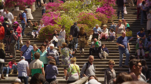 Slow motion still shot of crowded stairs at Trinità dei Monti Footage