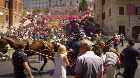 Slow motion pan of horse and buggy in front of Trinità dei Monti Footage
