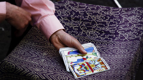 Slow motion shot of tarot card reading fanning cards on... Stock Video Footage