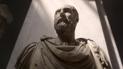 Tracking footage of bust of bearded man wearing ancient Roman clothing Footage