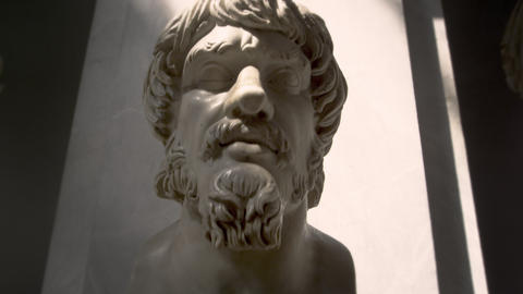Low-angle to high-angle shot of a man's bust Live Action