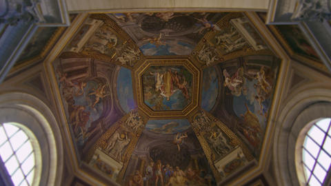 An ornately painted domed ceiling in the Vatican Museum Footage