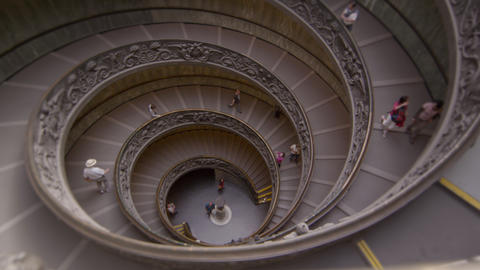 Tourists descend spiral stairs in slow motion Footage