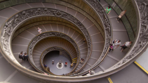 Time-lapse of tourists on large spiral staircase Footage