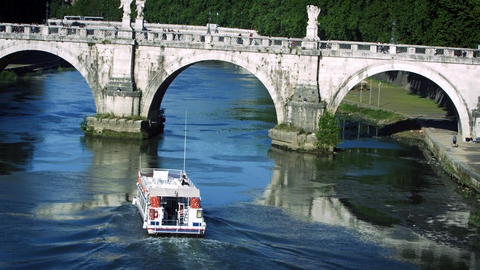 Barge approaches arch of Ponte Sant'Angelo Footage