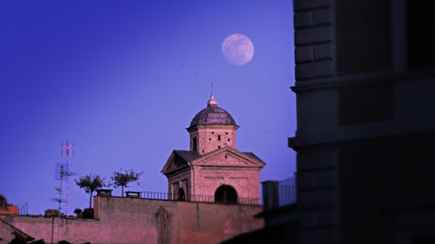 Moon behind small domed building Footage