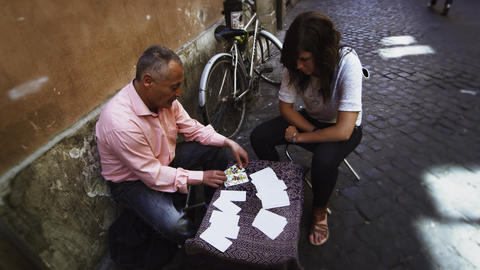 Woman receives her fortune on a Roman street. EDITED Stock Video Footage